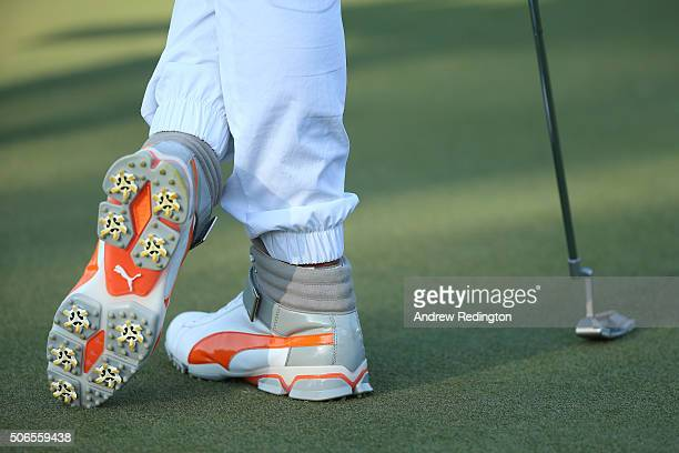 The shoes worn by Rickie Fowler of the United States are pictured during round four of the Abu Dhabi HSBC Golf Championship at the Abu Dhabi Golf...