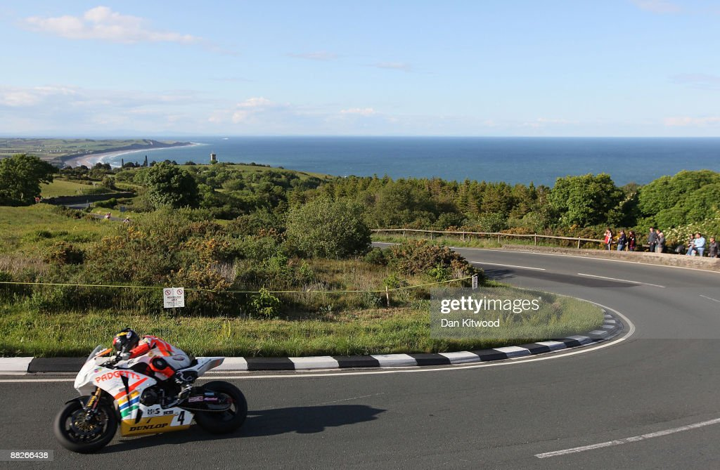 The shore off Ramsey catches the evening light in the distance as a competitor rides during a practice session on June 5, 2009 on the Isle Of Man, United Kingdom. Adverse weather conditions prevented the much anticipated Superbike race from taking place on Saturday and, depending on the rain, may be off all weekend. The annual TT race is one of the highlights of the motorbike racing calender with fans travelling from around the globe to watch riders compete in the 37 and three quarter mile lap exceeding speeds of 200mph.