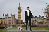 The shortest man ever Chandra Bahadur Dangi meets the worlds tallest man Sultan Kosen for the very first time on November 13 2014 in London England...