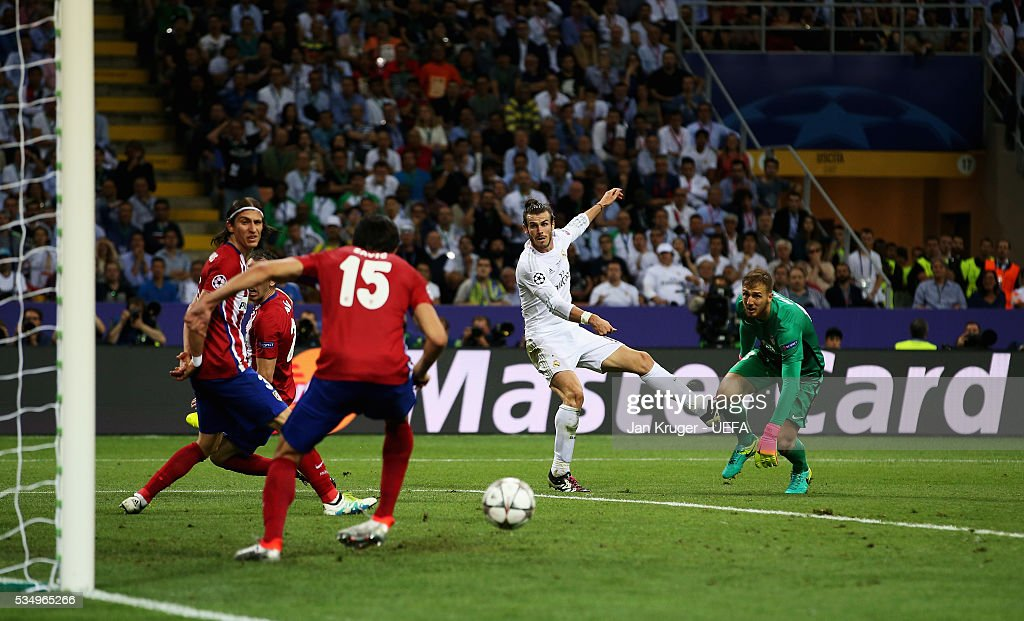 The shot by <a gi-track='captionPersonalityLinkClicked' href=/galleries/search?phrase=Gareth+Bale&family=editorial&specificpeople=609290 ng-click='$event.stopPropagation()'>Gareth Bale</a> of Real Madrid is cleared by <a gi-track='captionPersonalityLinkClicked' href=/galleries/search?phrase=Stefan+Savic&family=editorial&specificpeople=6135329 ng-click='$event.stopPropagation()'>Stefan Savic</a> of Atletico Madrid during the UEFA Champions League Final between Real Madrid and Club Atletico de Madrid at Stadio Giuseppe Meazza on May 28, 2016 in Milan, Italy.