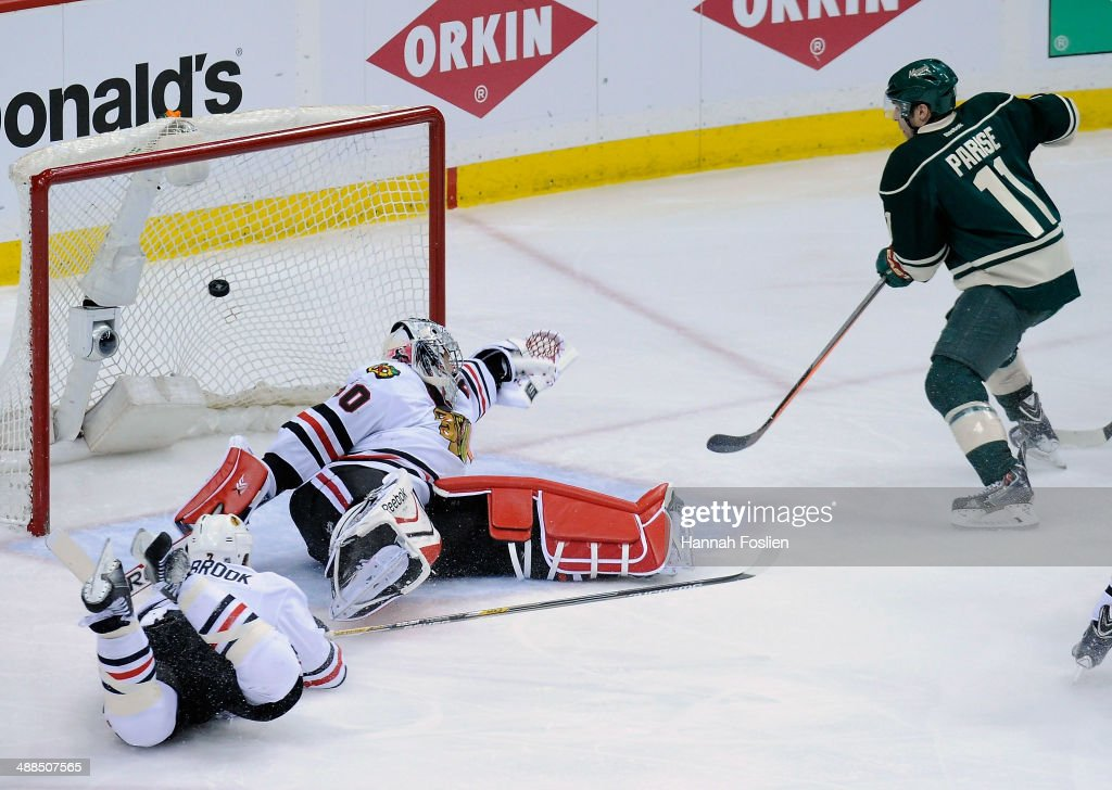 The shot by Mikael Granlund #64 of the Minnesota Wild (not pictured) gets past <a gi-track='captionPersonalityLinkClicked' href=/galleries/search?phrase=Brent+Seabrook&family=editorial&specificpeople=638862 ng-click='$event.stopPropagation()'>Brent Seabrook</a> #7 and <a gi-track='captionPersonalityLinkClicked' href=/galleries/search?phrase=Corey+Crawford&family=editorial&specificpeople=818935 ng-click='$event.stopPropagation()'>Corey Crawford</a> #50 of the Chicago Blackhawks as <a gi-track='captionPersonalityLinkClicked' href=/galleries/search?phrase=Zach+Parise&family=editorial&specificpeople=213606 ng-click='$event.stopPropagation()'>Zach Parise</a> #11 of the Minnesota Wild looks on during the third period in Game Three of the Second Round of the 2014 NHL Stanley Cup Playoffs on May 6, 2014 at Xcel Energy Center in St Paul, Minnesota. The Wild defeated the Blackhawks 4-0.
