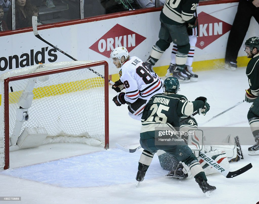 The shot by Patrick Kane #88 of the Chicago Blackhawks hits off the post, but is deflected into the net to score the game-winning goal as Ilya Bryzgalov #30 and Jonas Brodin #25 of the Minnesota Wild look on during overtime in Game Six of the Second Round of the 2014 NHL Stanley Cup Playoffs on May 13, 2014 at Xcel Energy Center in St Paul, Minnesota. The Blackhawks defeated the Wild 2-1 in overtime.