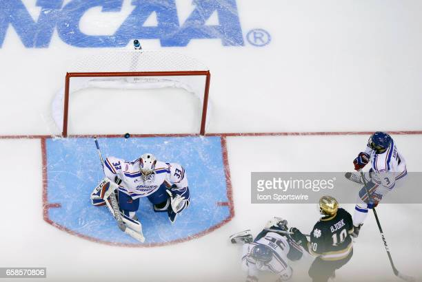The shot from Notre Dame Fighting Irish center Andrew Oglevie beats UMass Lowell River Hawks goaltender Tyler Wall for the game winner as Notre Dame...