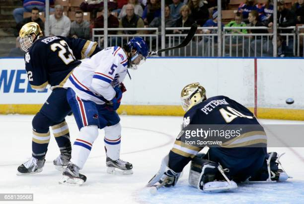 The shot from UMass Lowell River Hawks right wing John Edwardh beats Notre Dame Fighting Irish goaltender Cal Petersen for a 21 lead during the NCAA...