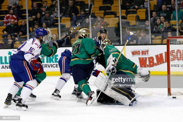 The shot from UMass Lowell Riverhawks center Ryan Lohin beats Notre Dame Fighting Irish goaltender Cal Petersen for a 21 lead during a Hockey East...