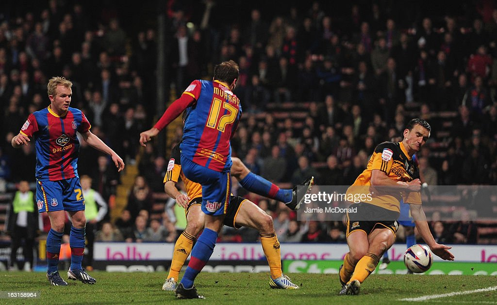 The shot of Glenn Murray of Crystal Palce strikes the arm of James Chester of Hull City for a penalty during the npower Championship match between Crystal Palace and Hull City at Selhurst Park on March 5, 2013 in London, England.