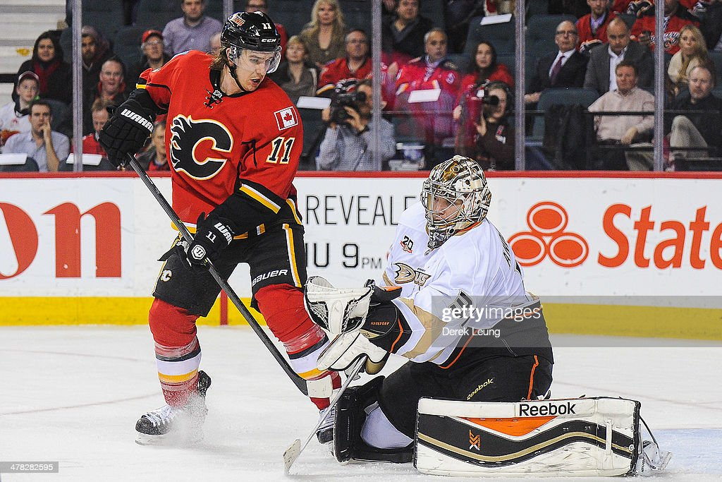 The shot of <a gi-track='captionPersonalityLinkClicked' href=/galleries/search?phrase=Mikael+Backlund&family=editorial&specificpeople=4324942 ng-click='$event.stopPropagation()'>Mikael Backlund</a> #11 of the Calgary Flames is stopped by <a gi-track='captionPersonalityLinkClicked' href=/galleries/search?phrase=Frederik+Andersen&family=editorial&specificpeople=6605243 ng-click='$event.stopPropagation()'>Frederik Andersen</a> #31 of the Anaheim Ducks during an NHL game at Scotiabank Saddledome on March 12, 2014 in Calgary, Alberta, Canada. The Flames defeated the Ducks 7-2.