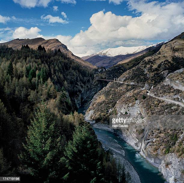 The Shotover River winds its way through Skippers Canyon surrounded by mountain peaks and gorges a short distance from Queenstown in New Zealand In...