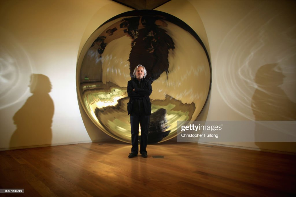 Artist <a gi-track='captionPersonalityLinkClicked' href=/galleries/search?phrase=Anish+Kapoor&family=editorial&specificpeople=3965986 ng-click='$event.stopPropagation()'>Anish Kapoor</a> stands next to a detail from his work 'Her Blood' part of his exhibition Flashback at Manchester Art Gallery on March 3, 2011 in Manchester, England. The touring exhibition from the Arts Council Collection and private owners is being shown March 5 - June 5, 2011. The show includes recent unseen works and pieces from his early career.