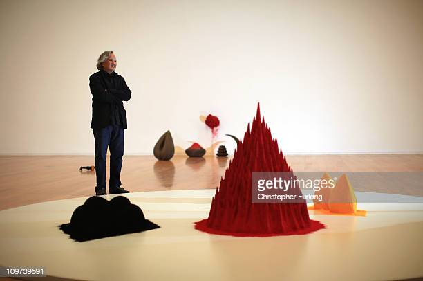 Artist Anish Kapoor stands next to his work 'White Sand Red Millet Many Flowers' part of his exhibition Flashback at Manchester Art Gallery on March...