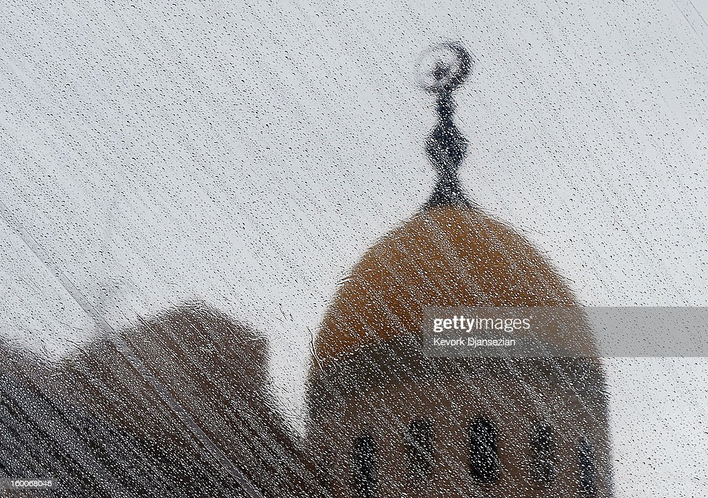 The Shrine Auditorium minaret i seen through the raindrop covered tent above the red carpet arrival area for the 19th Annual Screen Actors Guild Awards on January 25, 2013 in Los Angeles, California. The forcast calls for rain for the 19th Annual Screen Actors Guild Awards scheduled for Sunday January 27, 2013.