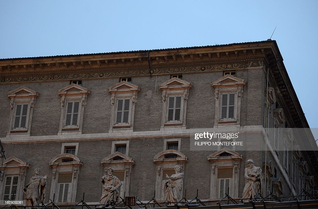 The shut windows of Pope Benedict XVI appartments are seen from St. Peter's Square at the Vatican on March 01, 2013. Benedict XVI began his life of retirement by watching a bit of television, getting a good night's sleep and reciting the rosary, the Vatican said Friday, a day after his resignation.
