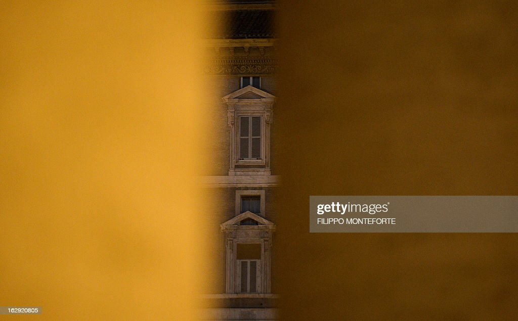 The shut windows of Pope Benedict XVI appartments are seen from the St.Peter's Square at the Vatican on March 01, 2013. Pope Benedict XVI has become the day before the first pope to resign in over 700 years, telling a tearful crowd of faithful that he will now be 'a simple pilgrim' as cardinals on Friday begin preparing for a conclave in the Sistine Chapel to elect his successor.