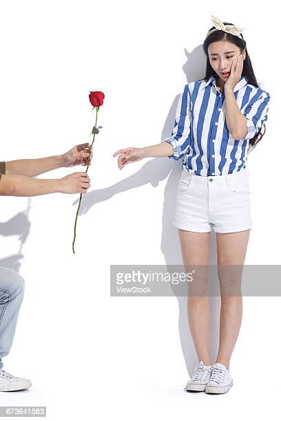 The shy young woman received a rose
