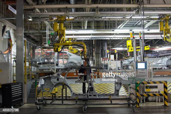 The side frames of Volkswagen AG Vento automobiles move along the production line at the Volkswagen India Pvt plant in Chakan Maharashtra India on...