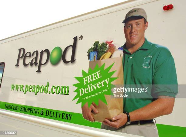 The side of a Peapod delivery truck is seen May 17 2001 at a Peapod's warehouse in Niles IL Peapod an online grocery supermarket plans to upgrade...