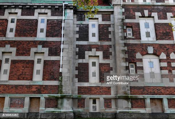 The side of one of the buildings of the The Ellis Island Hospital is seen on August 5 a 750bed facility which treated over 12 million patients and...