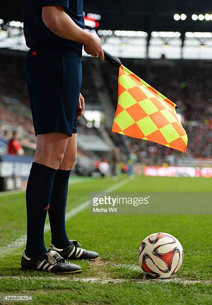 The sideline referee points at the corner signaling a corner kick during the Bundesliga match between FC Augsburg and 1 FC Koeln at SGL Arena on May...
