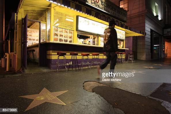 The sidewalk along the Hollywood Walk of Fame in front of Molly's Charbroiled Burger House on Vine Street near the Hollywood landmark intersection of...