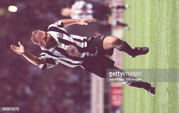 The sight Tyneside has been waiting for as Alan Shearer celebrates his first goal for Newcastle United in their Premiership match against Wimbledon...