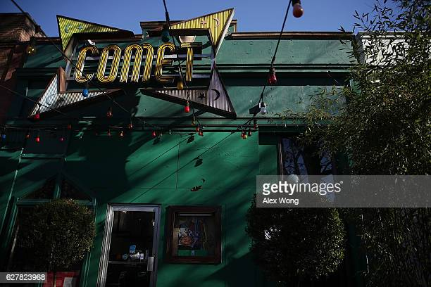 The sign and front entrance of Comet Ping Pong pizzeria are seen on Connecticut Avenue December 5 2016 in Washington DC A man was arrested Sunday...