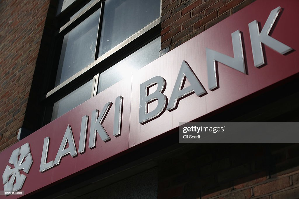 The sign for a branch of Laiki Bank UK, a subsiduary of Cyprus Popular Bank, on April 2, 2013 in London, England. Customers with funds in Laiki Bank UK will not face a levy on their accounts, which is being imposed in Cyprus on deposits of over 100,000 Euros as part of the European Union's bail-out package for the Cypriot economy. The Bank of England's Prudential Regulation Authority has announced that all deposits in Laiki Bank UK will be automatically transferred to Bank of Cyprus in the UK.