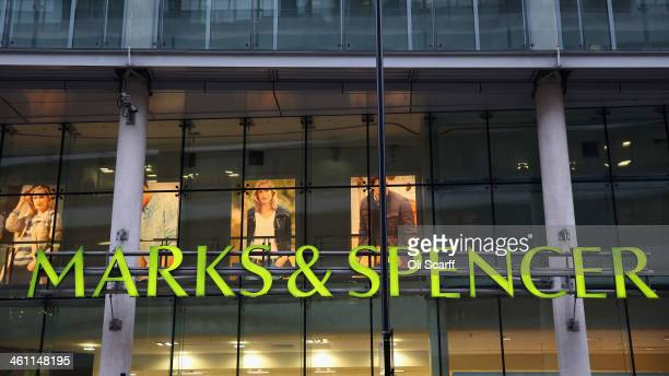 The sign for a branch of Marks Spencer is displayed on January 7 2014 in London England The food and clothing retailer which has traded for 130 years...