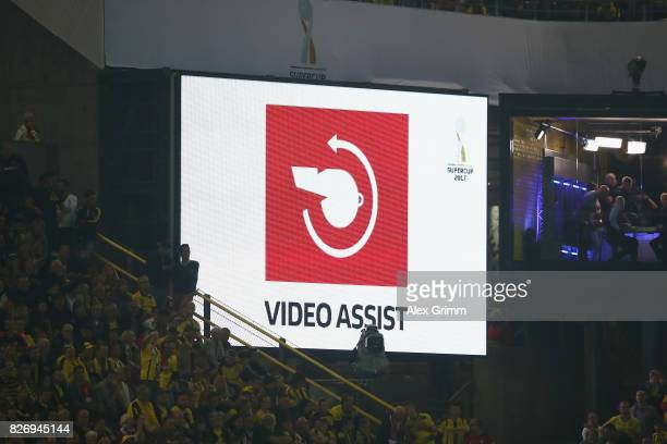 The sign for a video assistant referee investigation is seen on the screen during the DFL Supercup 2017 match between Borussia Dortmund and Bayern...