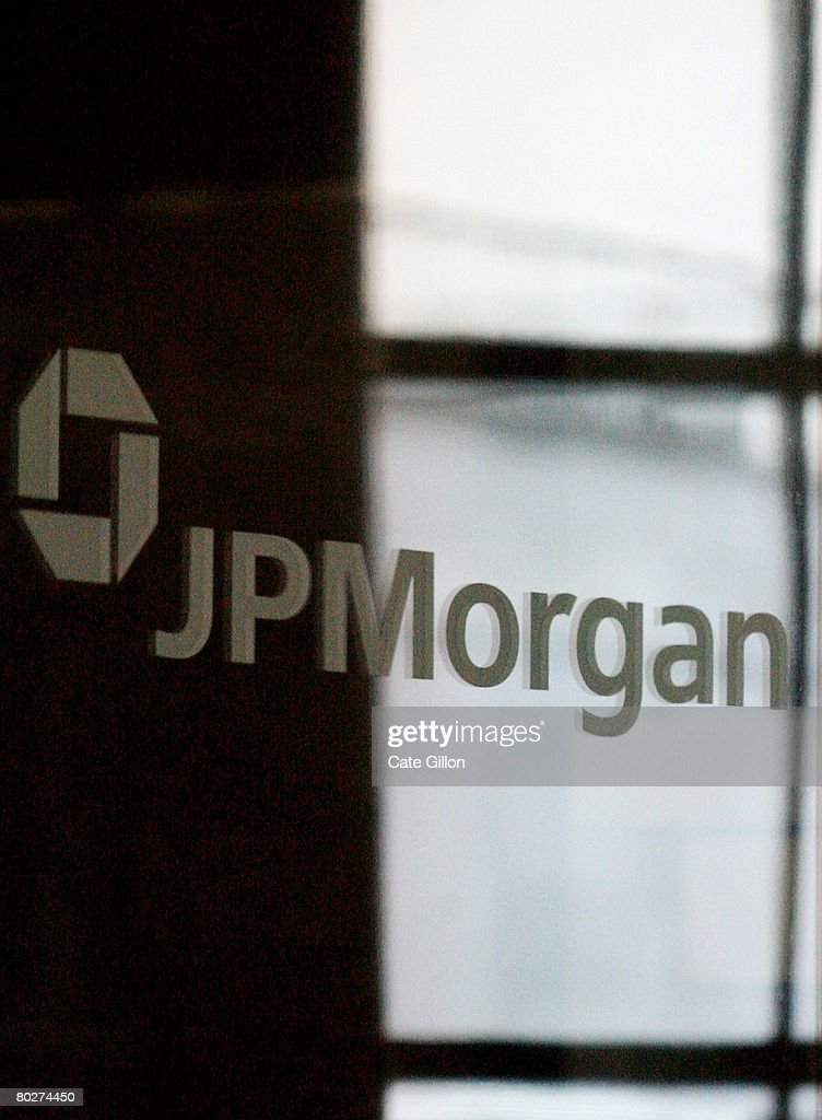 The sign for JP Morgan is featured on a mirror in the headquarters of the bank JP Morgan Chase on March 17 2008 in London England JP Morgan Chase has...