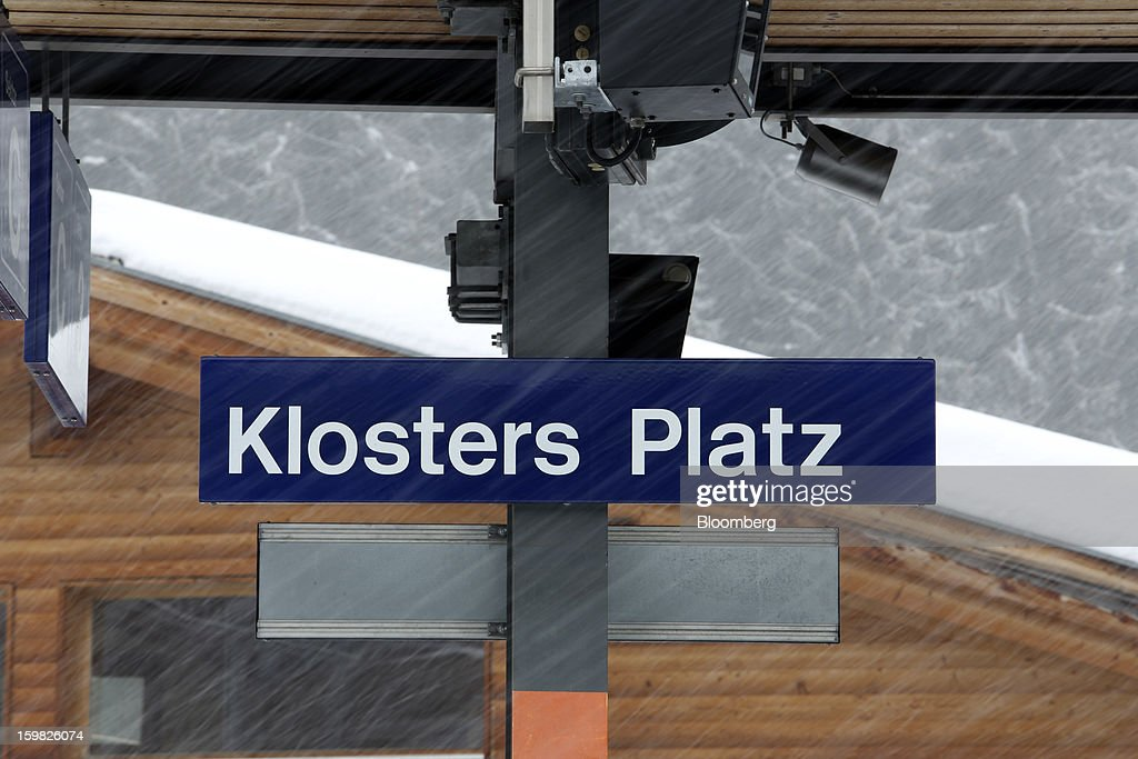 The sign for the Klosters Platz railway station is seen during a snow storm at Klosters, Switzerland, on Monday, Jan. 21, 2013. This week the business elite gathers in the Swiss Alps for the 43rd annual meeting of the World Economic Forum in Davos, the five day event runs from Jan. 23-27. Photographer: Chris Ratcliffe/Bloomberg via Getty Images