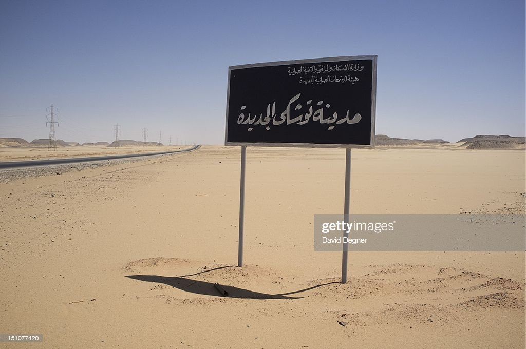 The sign for the New City of Toshka stands in the desert, March 15, 2012. The Toshka Project is an attempt to create a vast agricultural oasis out of desert and water diverted from the nile. Building started 10 years ago and was seen as Mubarak's pyramid. Now it continues to slowly grow at a fraction of it's original design.