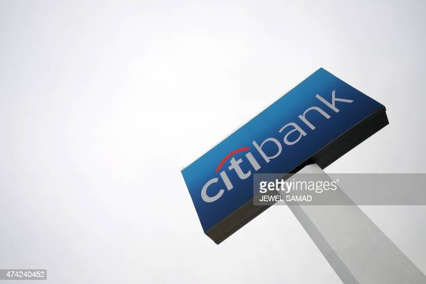 The sign of a Citibank is pictured at a branch in New York on May 21 2015 US and British regulators fined six major global banks a total of nearly 6...