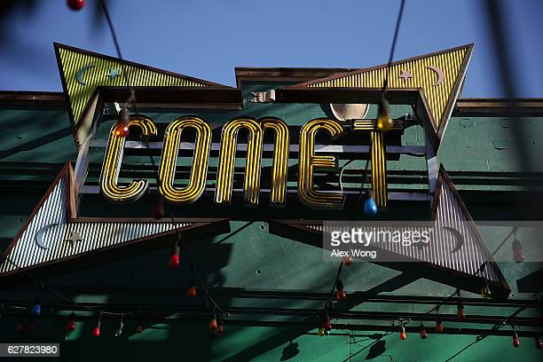 The sign of Comet Ping Pong pizzeria is seen on Connecticut Avenue December 5 2016 in Washington DC A man was arrested Sunday after walking into the...
