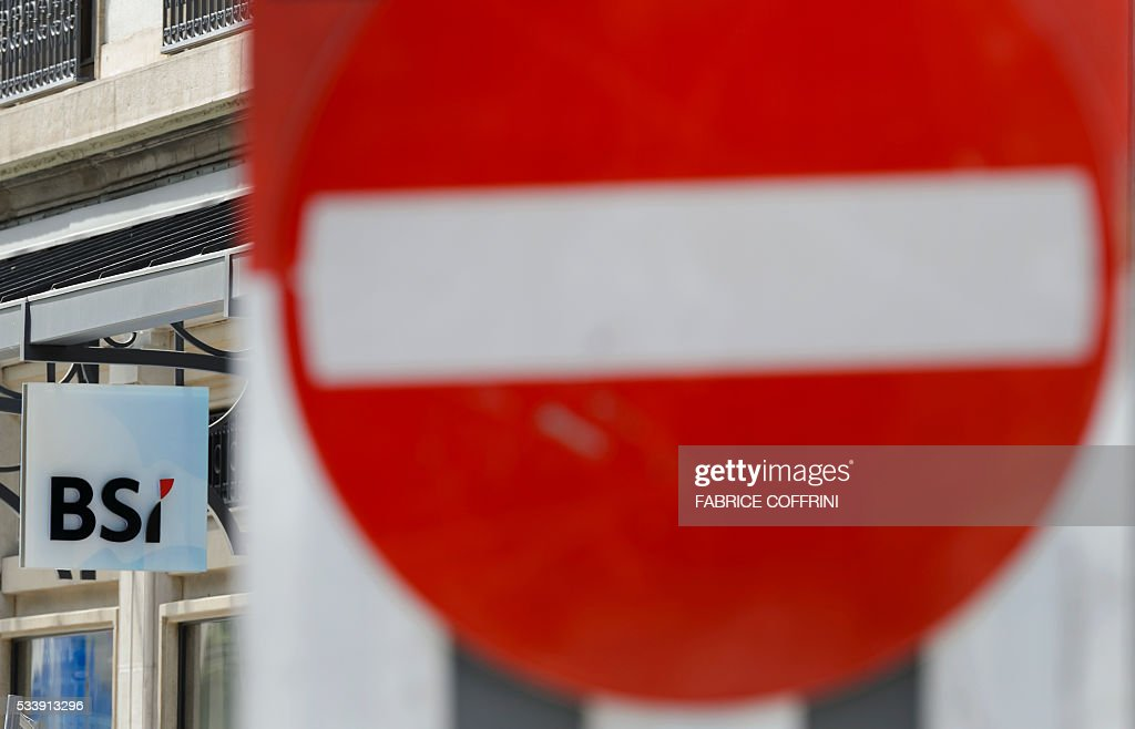 The sign of Swiss bank BSI is seen outside a subsidiary on May 24, 2016 in Geneva. Swiss financial regulators approved on May 24 the dissolution of Lugano-based BSI Bank over its links to a corruption scandal engulfing Malaysia's Prime Minister Najib Razak. Swiss supervisor FINMA accused BSI, a merchant bank, of 'serious breaches' of money-laundering regulations in its dealings with the Malaysian sovereign wealth fund 1MDB, which is at the heart of the corruption allegations. / AFP / FABRICE
