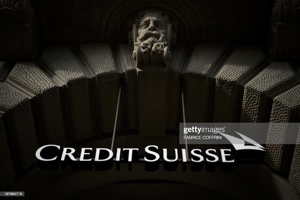 The sign of Swiss banking giant Credit Suisse is seen on November 2 2013 in Zurich AFP PHOTO / FABRICE COFFRINI