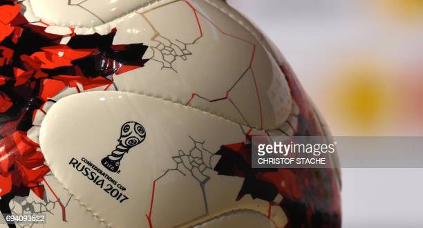 The sign of the football Confederations Cup 2017 in Russia is seen at the mini version of the official match ball 'Karsava' of the football...