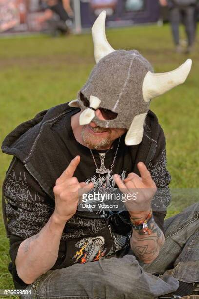 The sign of the horns is shown by many visitorsduring the Wacken Open Air festival on August 3 2017 in Wacken Germany Wacken is a village in northern...
