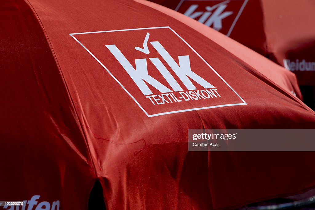 The sign of the the company Kik is seen outside a Kik discount textiles store on September 18, 2012 in Berlin, Germany. Kik, a nationwide discount clothing chain in Germany, is reportedly among the companies that sourced some of its production to the garment factory in Karachi, Pakistan, that recently burned down, killing at least 258 people.
