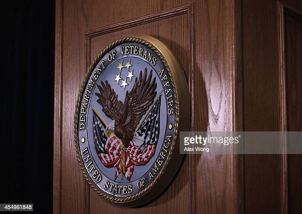 The sign of the Veterans Affairs Department is hung on the podium as US Secretary of Veterans Affairs Robert McDonald speaks during a news conference...