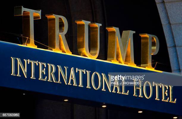 The sign on the Trump International Hotel is seen at sunset on March 23 2017 in Washington Earlier in the day the US federal agency that oversees US...