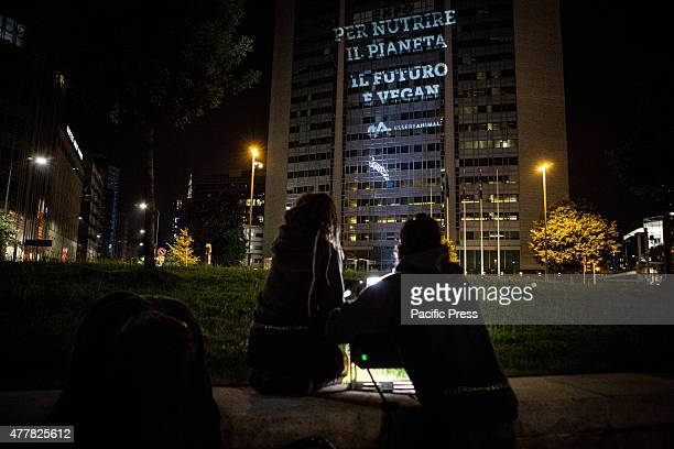 The sign 'To feed the planet the future is Veganism' was projected yesterday night on the Pirellone skyscraper in Milan Italy by 'Essere Animali'...