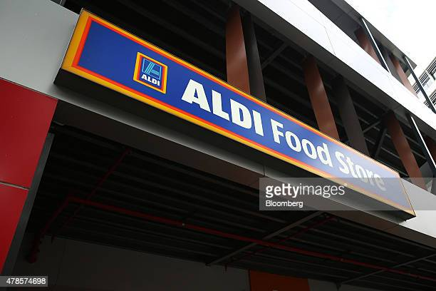 The signage for Aldi Stores Ltd food store is seen atop one of the company's stores in Sydney Australia on Thursday June 25 2015 Australia's biggest...