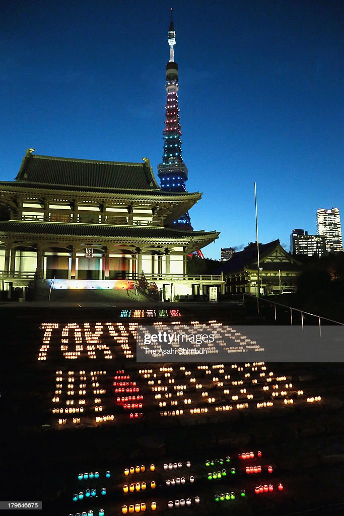 The signage saying 'TOKYO 2020 We Believe' made with candle lights are displayed in Zojoji Temple near Tokyo Tower on September 5, 2013 in Tokyo, Japan.