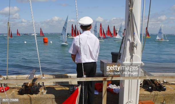 The Signalman watches the Redwing fleet start on the third day of Cowes Week the world famous sailing regatta held each year on the Solent