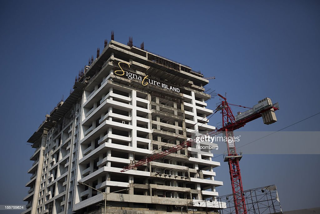 The Signature Island apartment building stands under construction in the Bandra Kurla Complex in Mumbai, India, on Tuesday, Nov. 6, 2012. Reserve Bank of India Governor Duvvuri Subbarao lowered the RBI's forecast for India's gross domestic product growth in the year through March to 5.8 percent, the slowest in almost a decade, from 6.5 percent. Photographer: Brent Lewin/Bloomberg via Getty Images