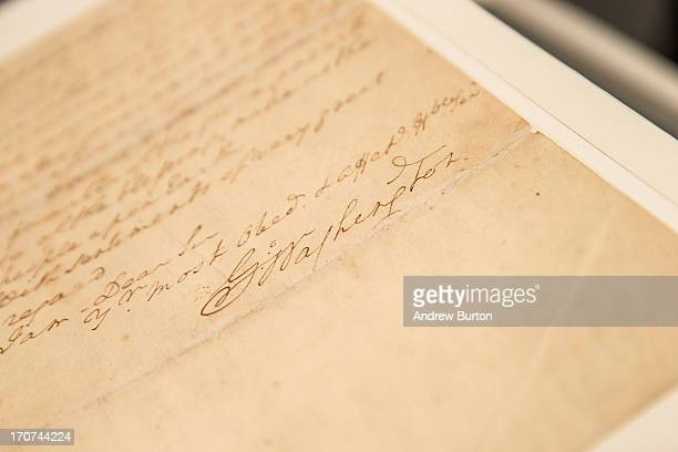 The signature of George Washington the first president of the United States is seen on a letter he wrote regarding the United States' constitution at...