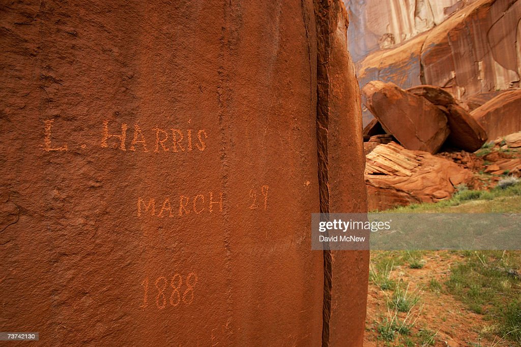 The signature of Utah pioneer Llewellyn Harris, dated March 29, 1888, remains undamaged above the high water mark of Lake Powell in his namesake Llewellyn Gulch canyon on March 28, 2007 near Page, Arizona. Lake Powell and the next biggest Colorado River reservoir, the nearly 100-year-old Lake Mead, are at the lowest levels ever recorded. Environmentalists have long-lamented the damming of scenic Glen Canyon, the eastern sibling of the Grand Canyon, in the early 1960's to create the 186-mile-long Lake Powell. The US Bureau of Reclamation is evaluating four proposals to manage the drought on the Colorado River which supplies water and power to millions of people in the western states. The bureau has warned that shortages are possible as early as 2010. If the water drops too far, power generators at the dams will become inoperable.