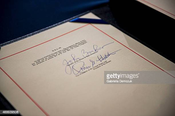 The signatures of House Speaker John Boehner and Sen Orrin Hatch on the Medicare Access CHIP Reauthorization Act 2015 HR 2 after a bipartisan press...