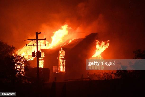 TOPSHOT The Signorello Estate winery burns in the Napa wine region in California on October 9 as multiple winddriven fires continue to whip through...