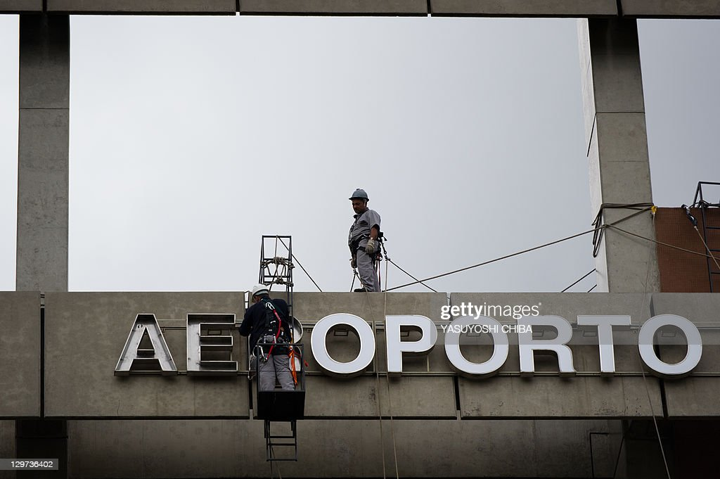 The signs of Sao Paulo's Guarulhos international airport is being refurbished on October 20 2011 The workers of Infraero the governmentowned airport...